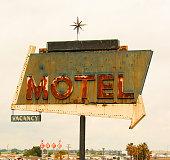 Retro style motel sign with arrow