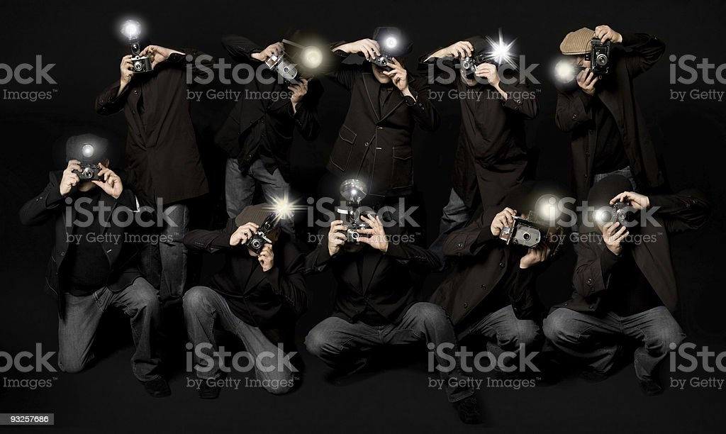 Retro Style Paparazzi Photojournalists stock photo