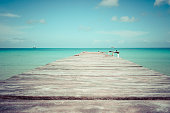 retro style photography: Wooden gangplank with caribbean sea view