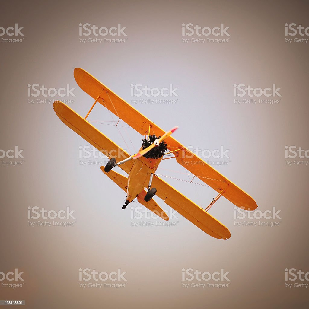 Retro style picture of the biplane. vector art illustration