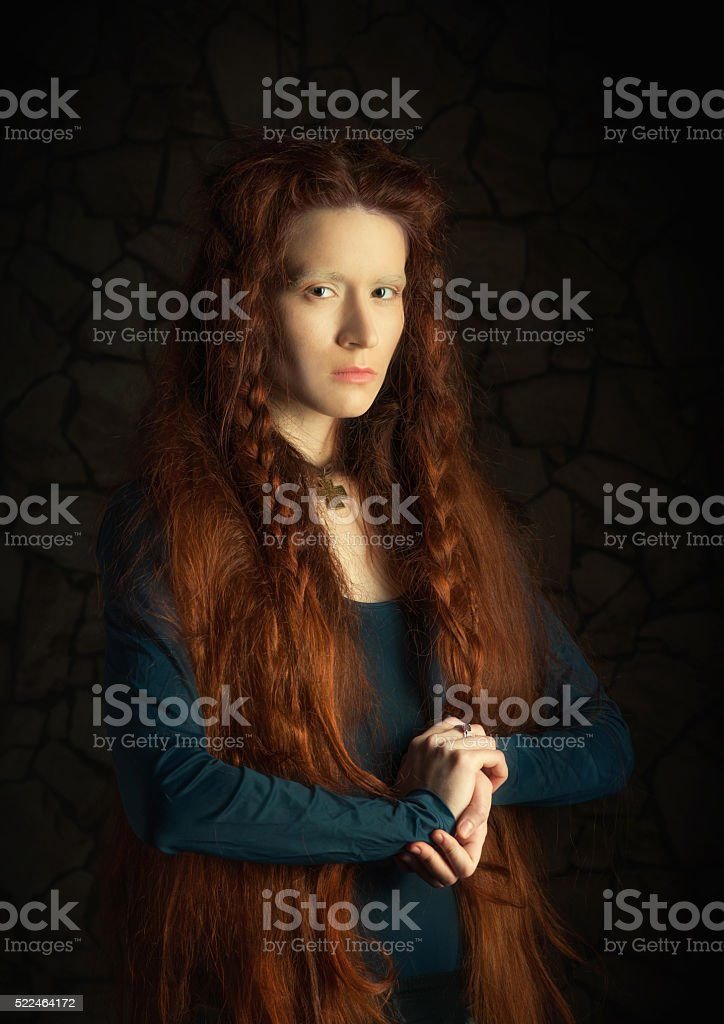 Retro style portrait of a redheaded woman stock photo