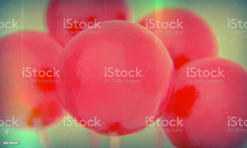 Retro style red balls of lollipops on a stick. Macro shot with shallow DOF stock photo