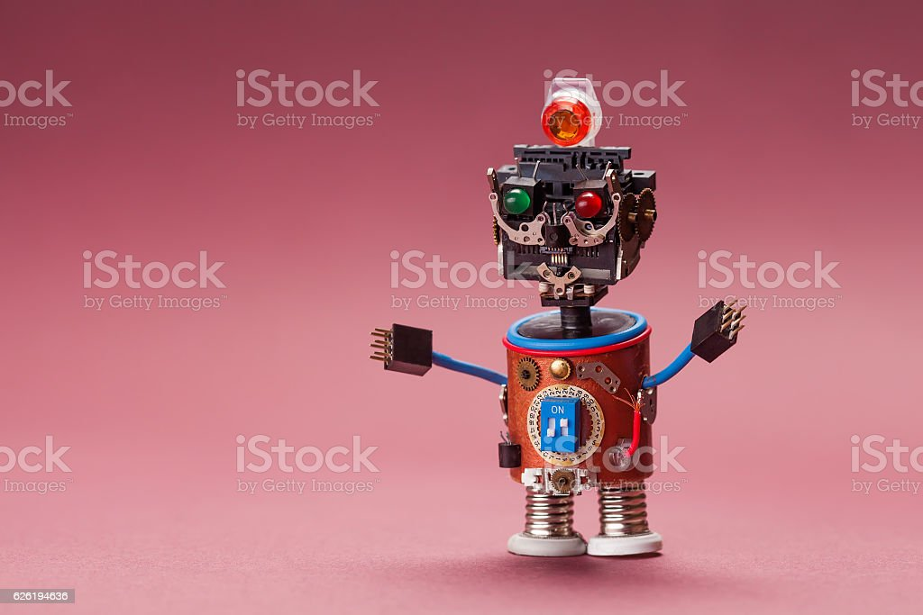 Retro style robot. Toy character with black plastic head, colored stock photo