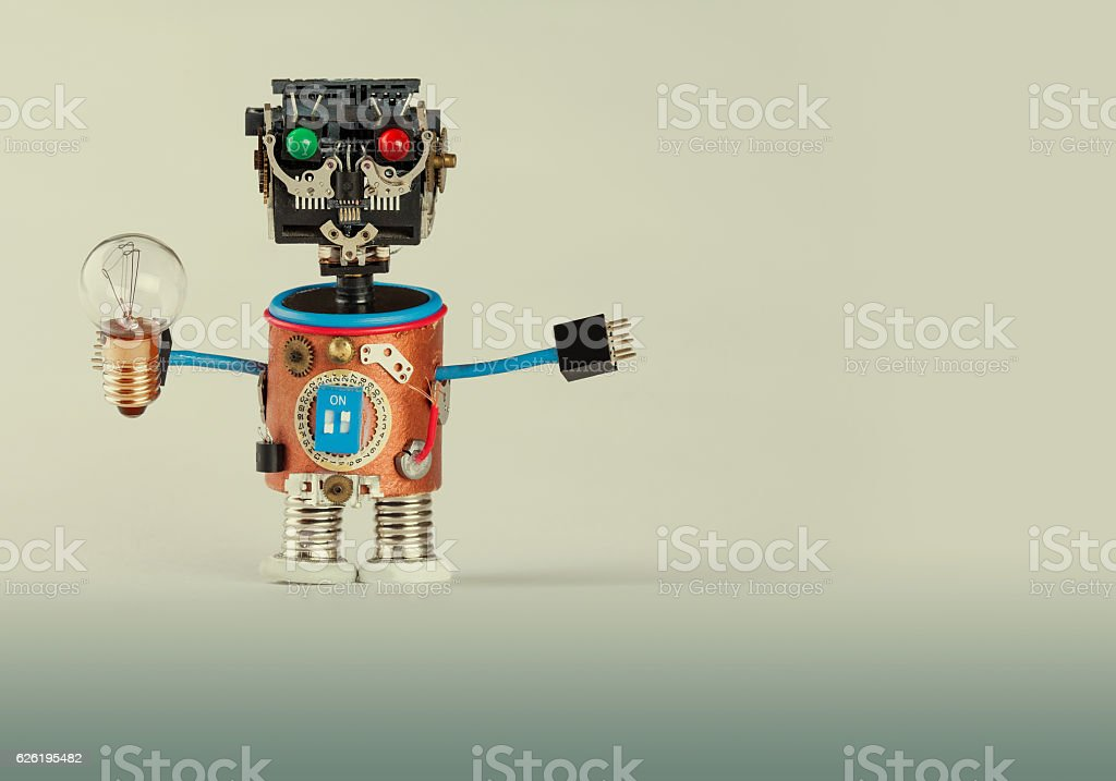 Retro style robot with light bulb. Plastic head, colored green stock photo