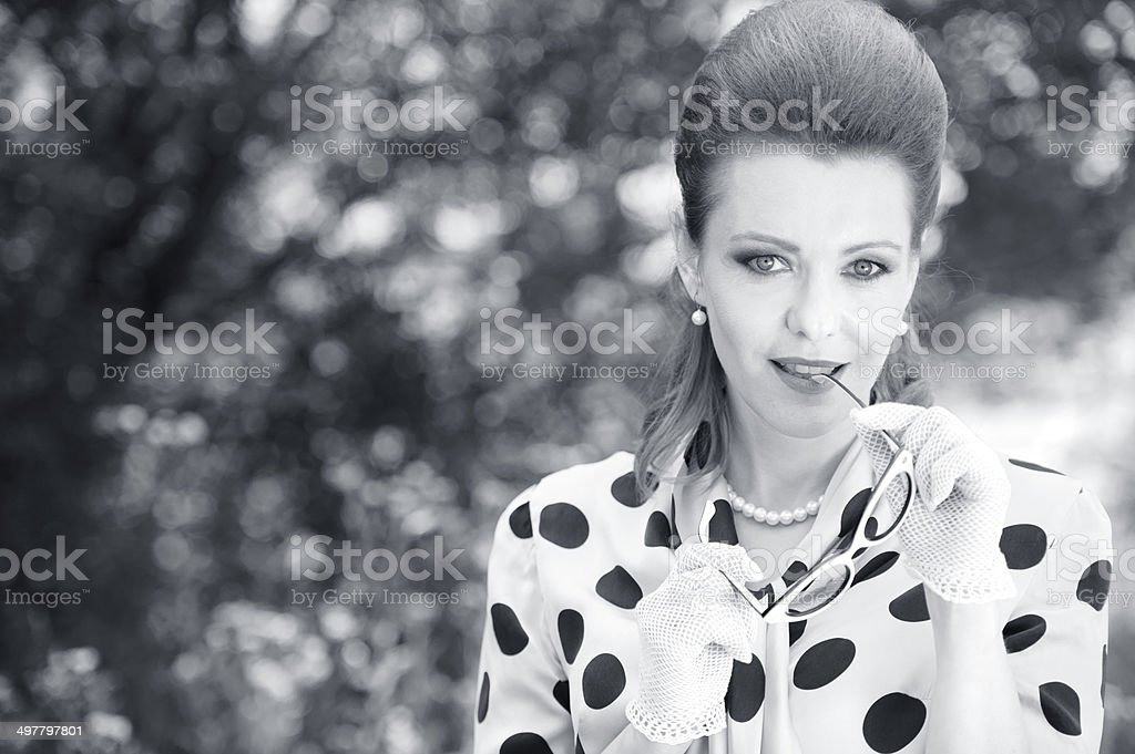 Retro Styled Black and White Woman Portrait in stock photo