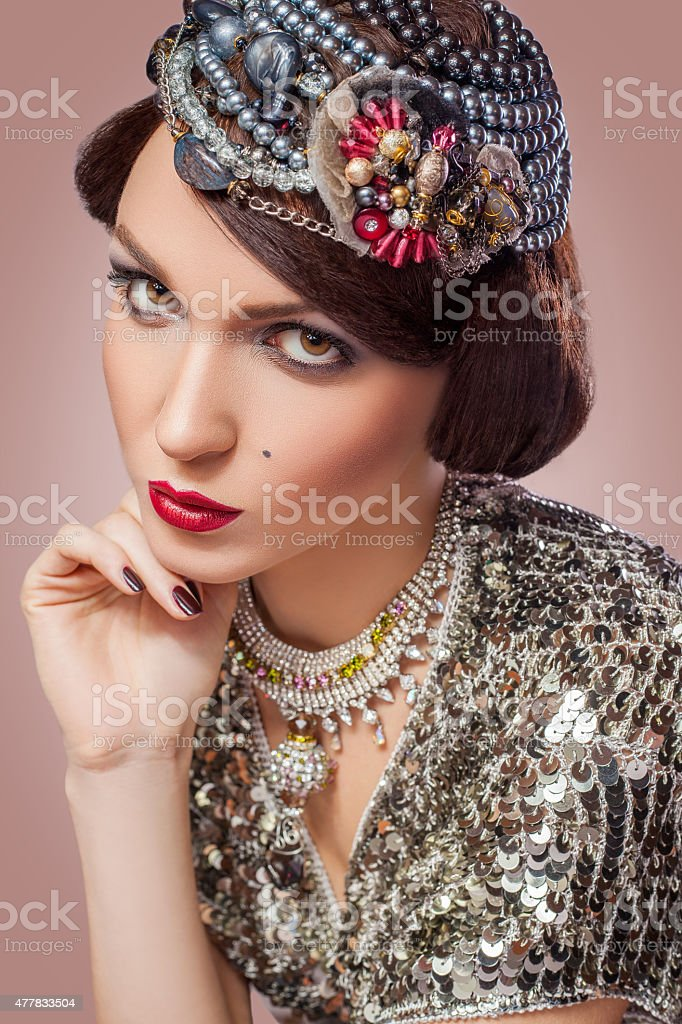 Retro styled fashion portrait of a young woman with pearls. stock photo