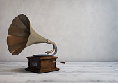 Retro styled gramophone in an empty modern room.
