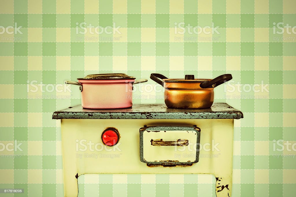 Retro styled image of a doll house cooking stove stock photo