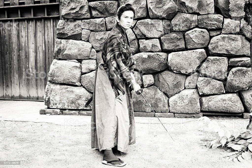 Retro styled image of a Samurai with his katana stock photo