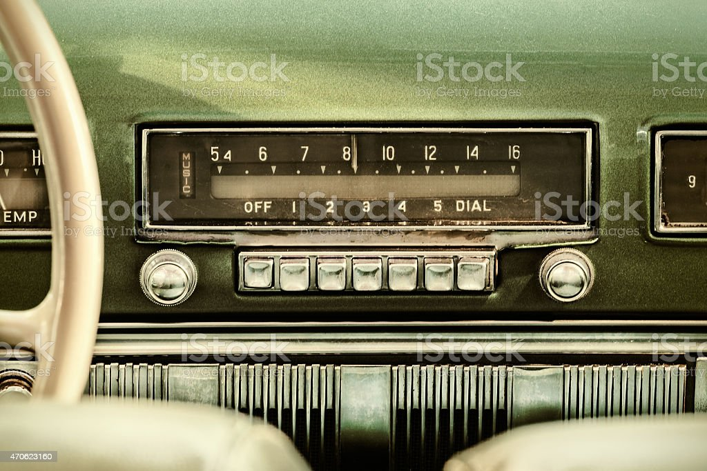 Retro styled image of an old car radio stock photo