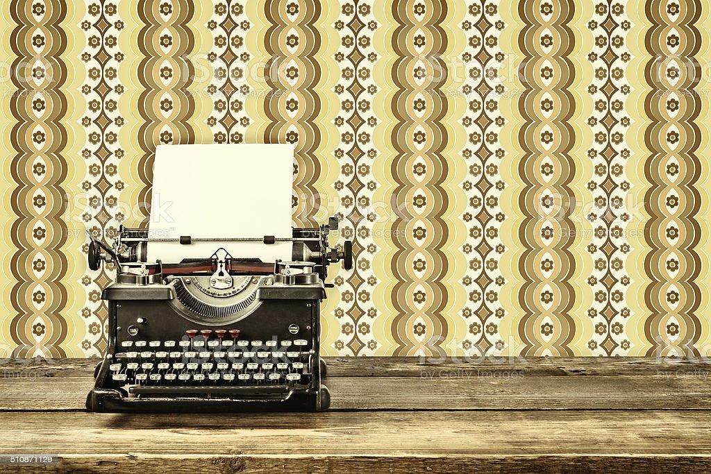 Retro styled image of an old typewriter stock photo