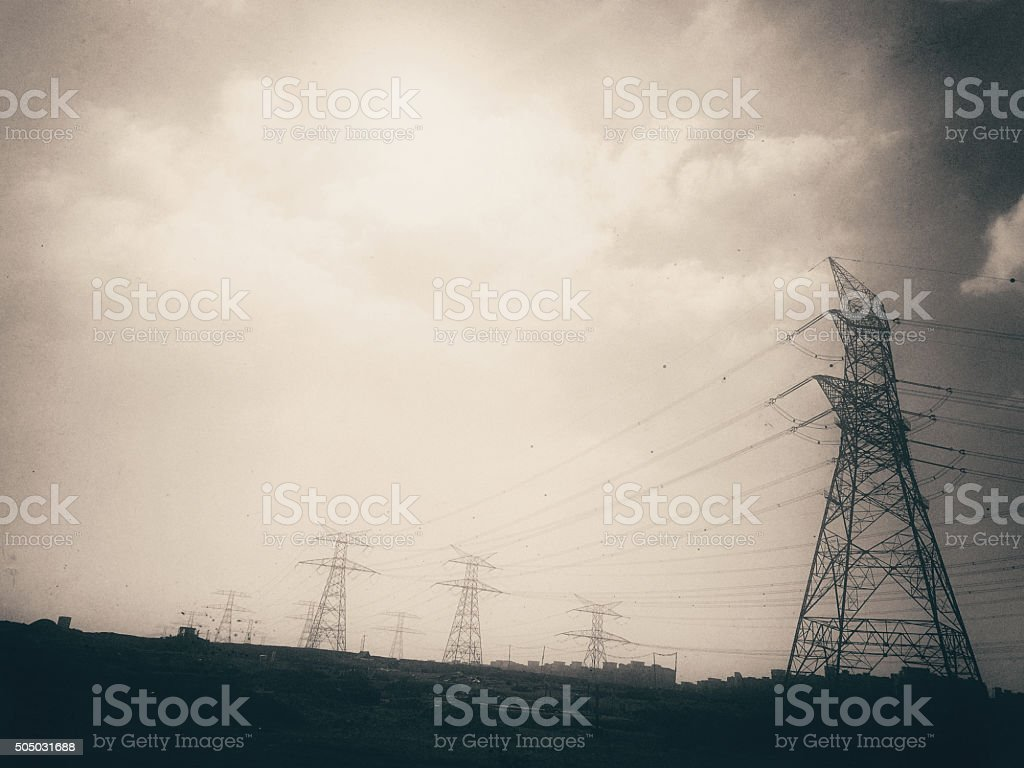 Retro Styled Image of Electrical Pylons in Sepia Tone stock photo