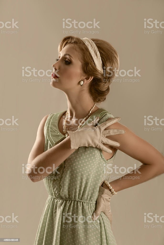 Retro styled image of fifties blonde woman with gloves stock photo