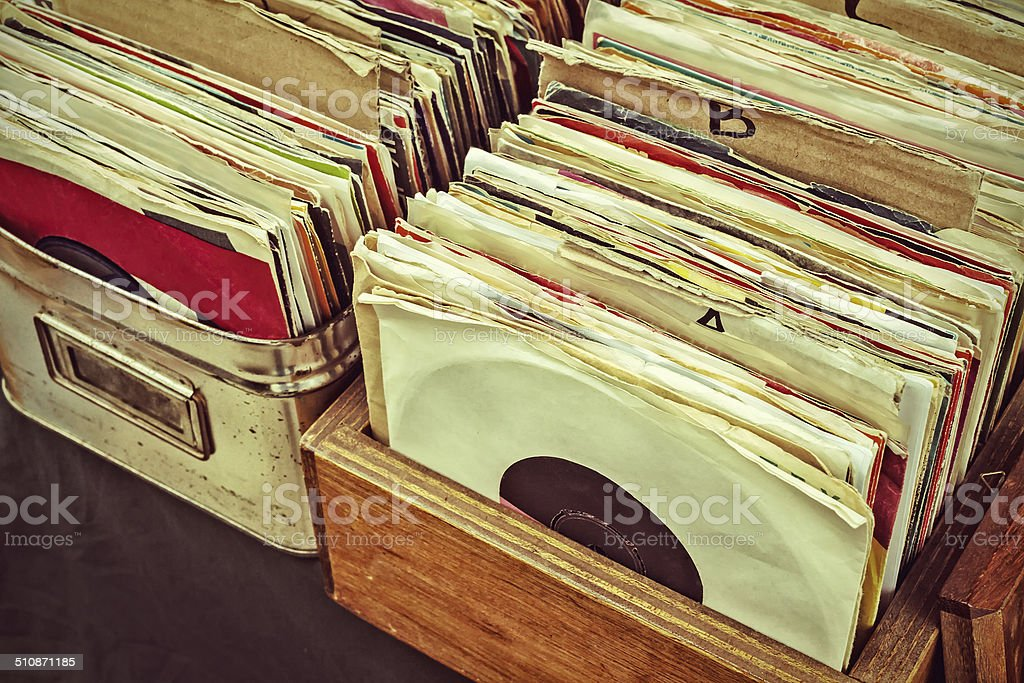 Retro styled image of lp records on a flee market stock photo