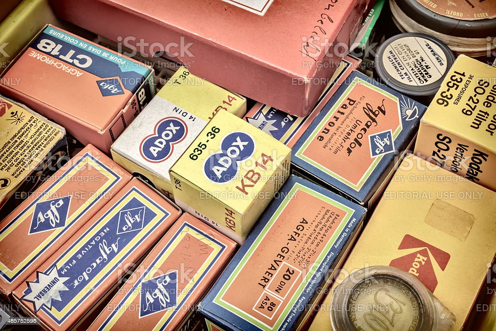 Retro styled image of old color slide film packs stock photo