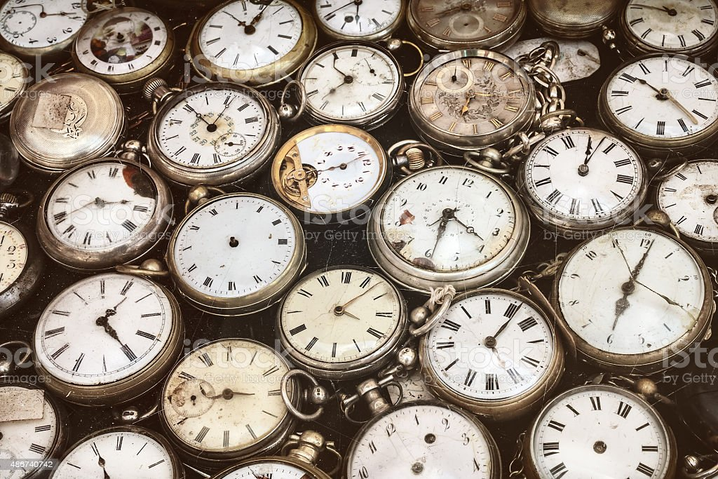 Retro styled image of old pocket watches stock photo