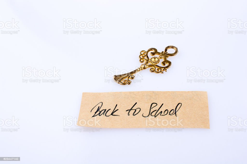 Retro styled key and back to school title stock photo