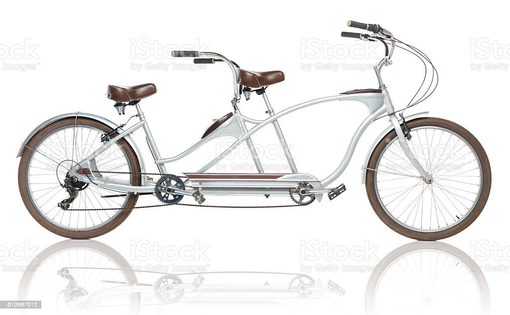 Retro styled tandem bicycle isolated on a white stock photo