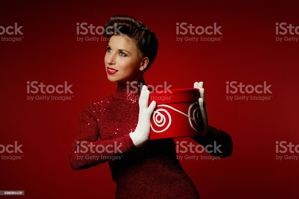 Retro Styled woman with Red Present stock photo