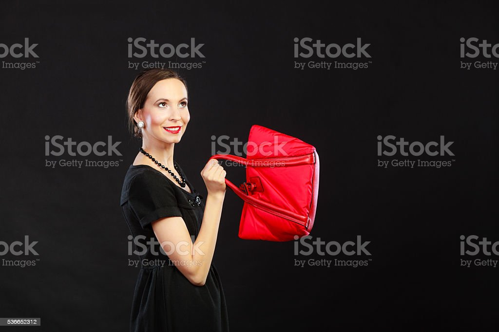 Retro stylish woman with red handbag stock photo