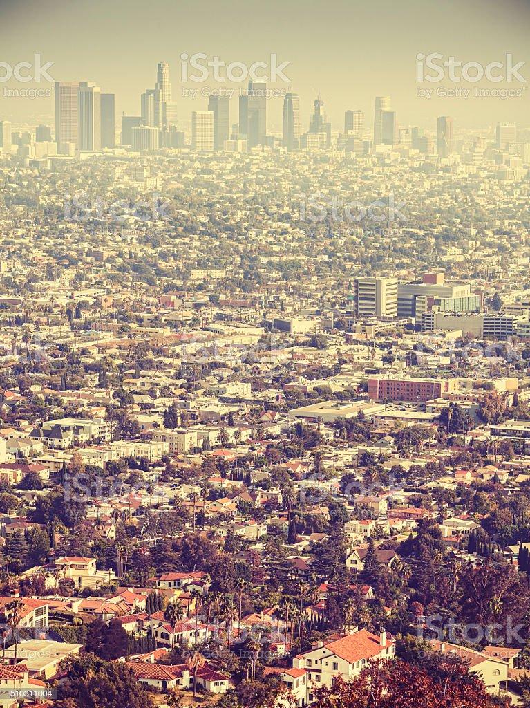 Retro stylized aerial view of Los Angeles seen through smog. stock photo