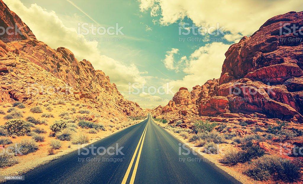 Retro stylized desert highway, travel adventure concept. stock photo