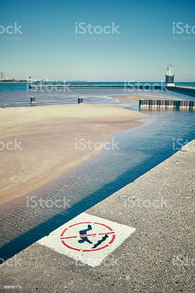 Retro stylized no diving sign on a pier. stock photo