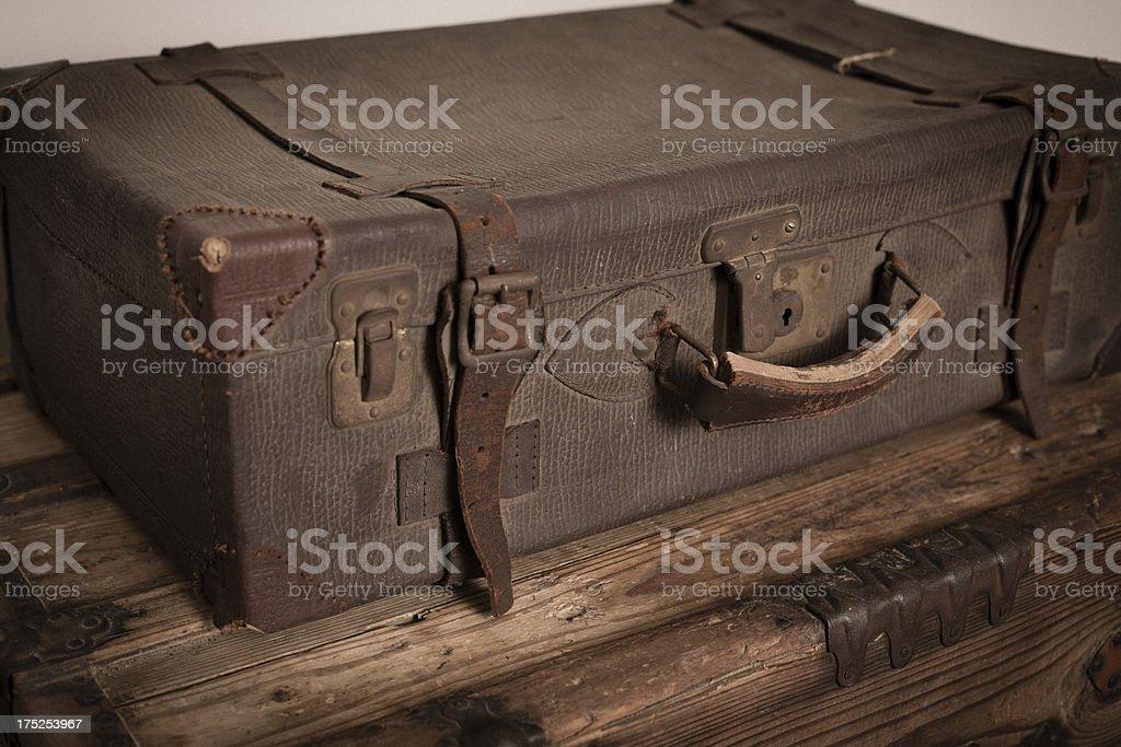 Retro Suitcase Sitting on Wood Trunk royalty-free stock photo