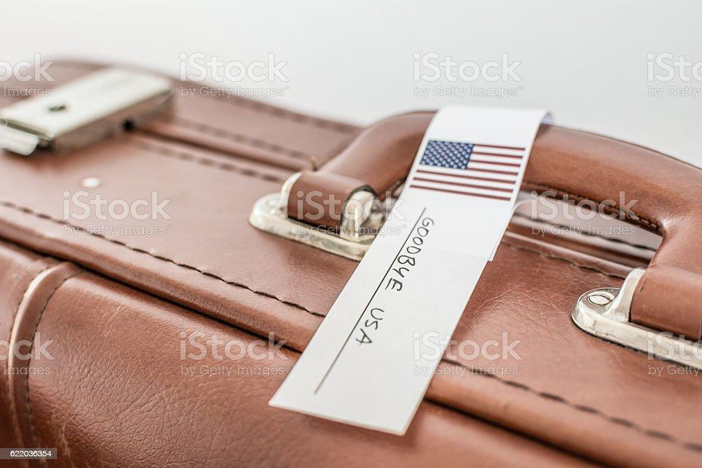 Retro suitcase with 'Goodbye USA' tag. stock photo