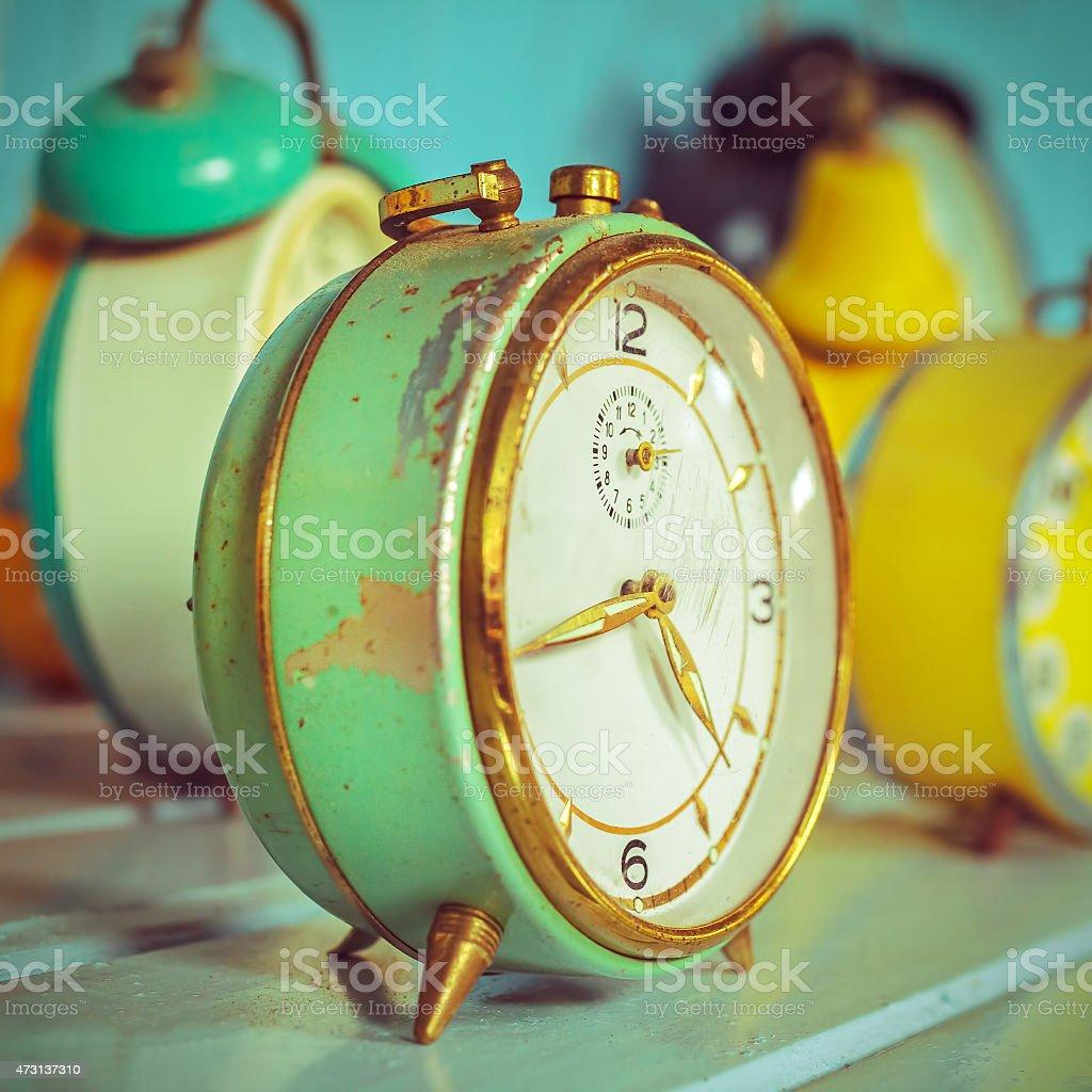 Retro syled image of ancient alarm clocks stock photo