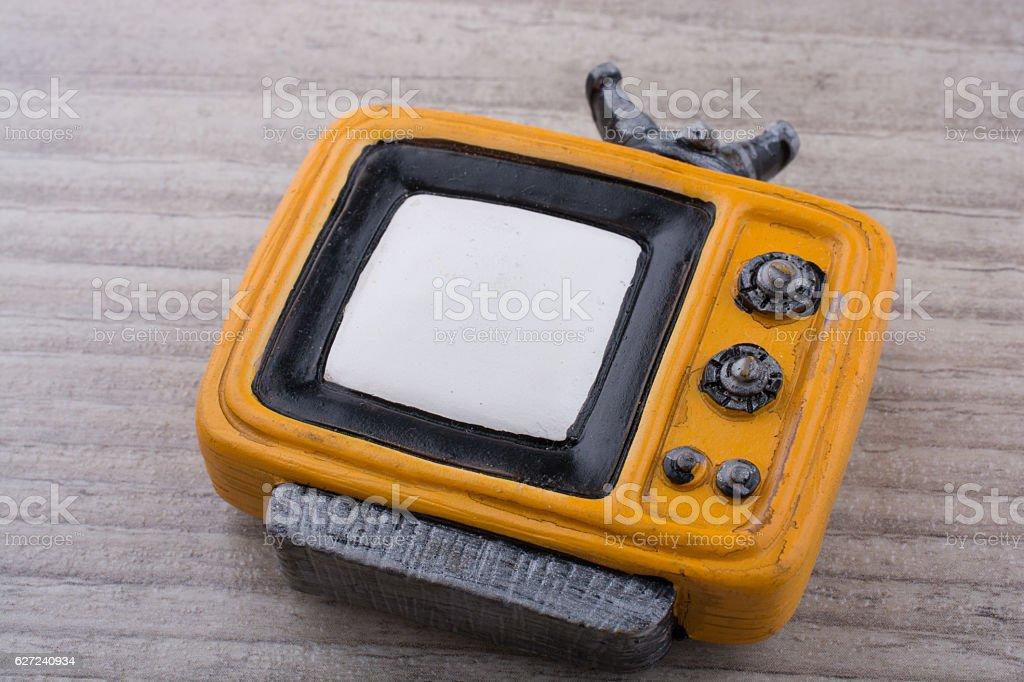 Retro syled tiny television model on grey background stock photo
