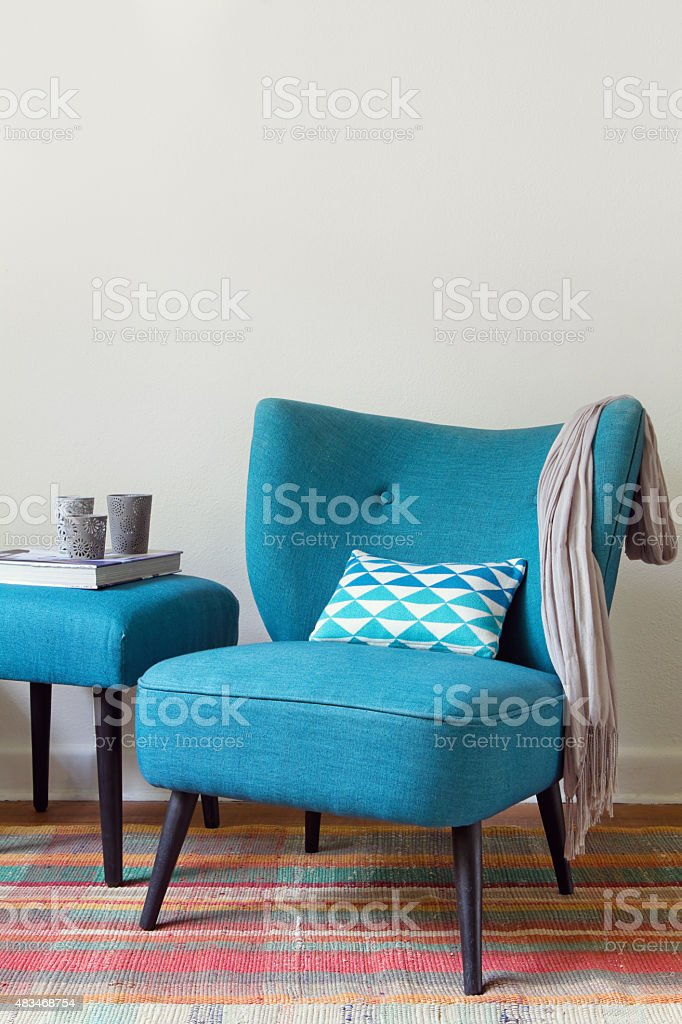 Retro teal armchair and ottoman decor items home interior stock photo