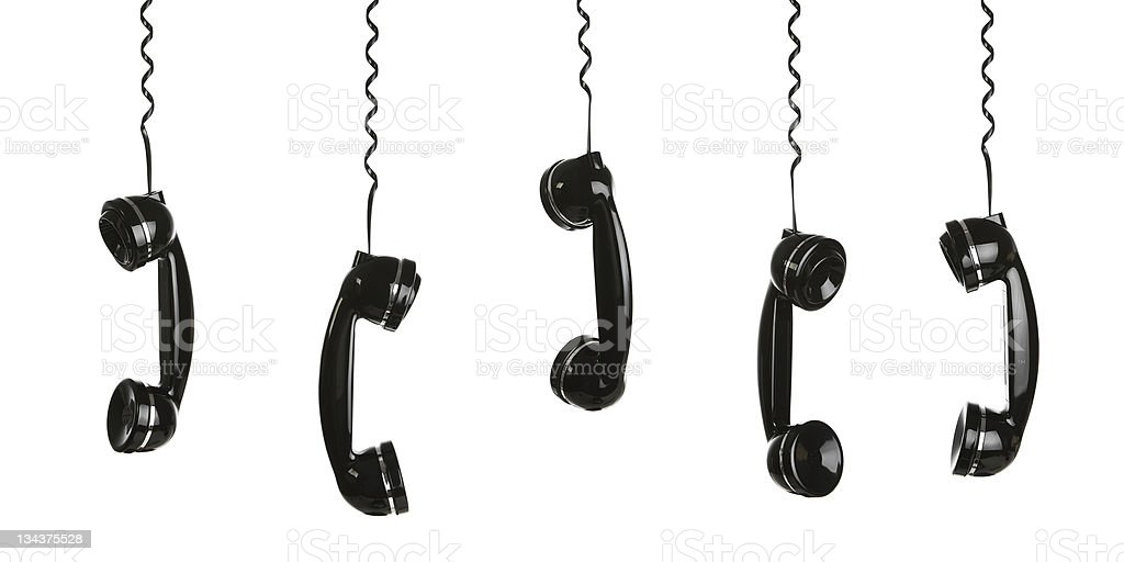Retro telephones hanging by their phone cords royalty-free stock photo