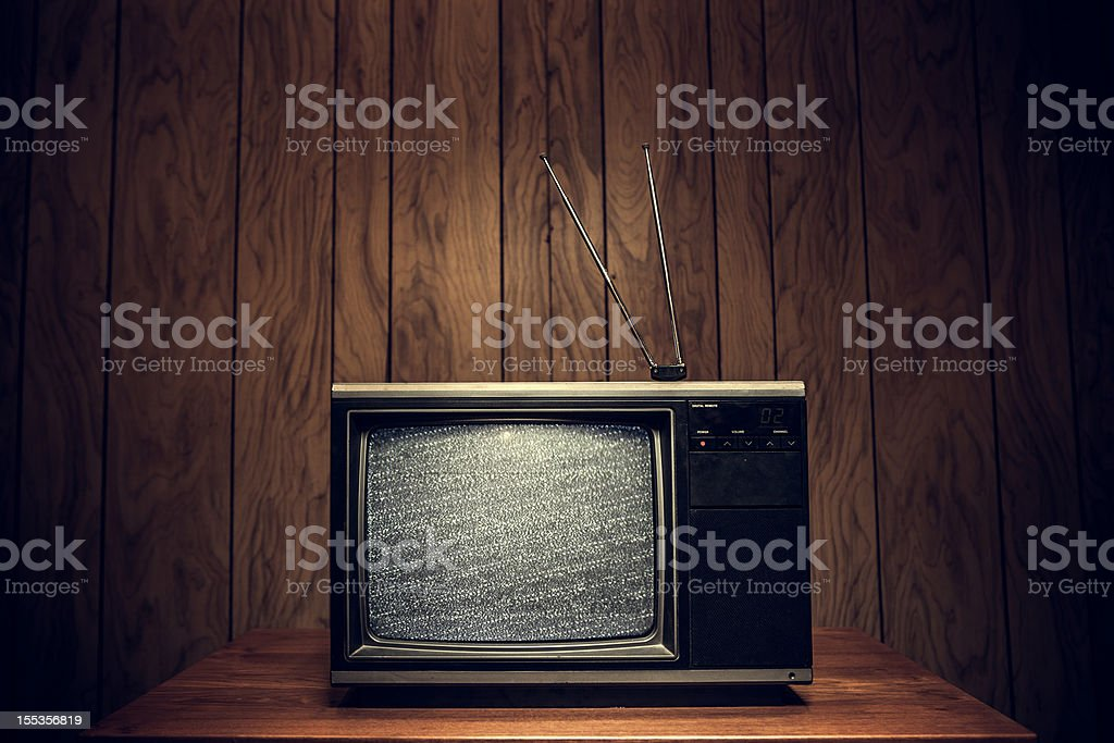 Retro Television in Wood Paneled Living Room stock photo
