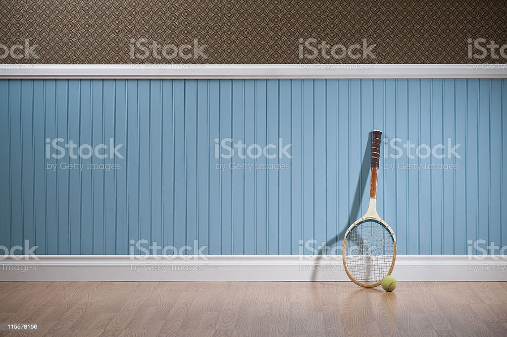 Retro Tennis Racket In Empty Room royalty-free stock photo