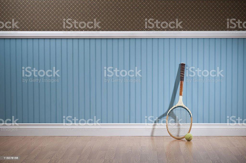 Retro Tennis Racket In Empty Room stock photo