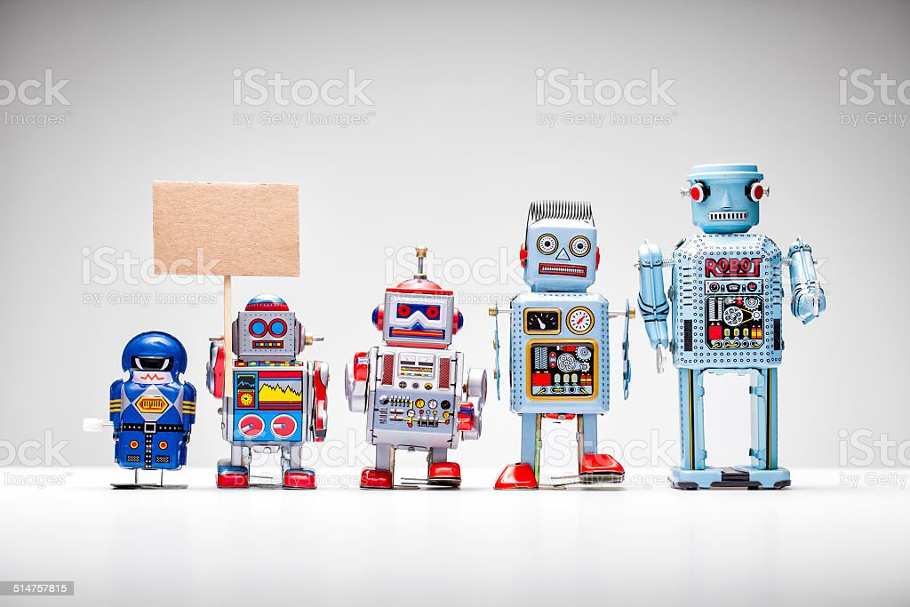 Retro tin toy robot holding up a sign stock photo