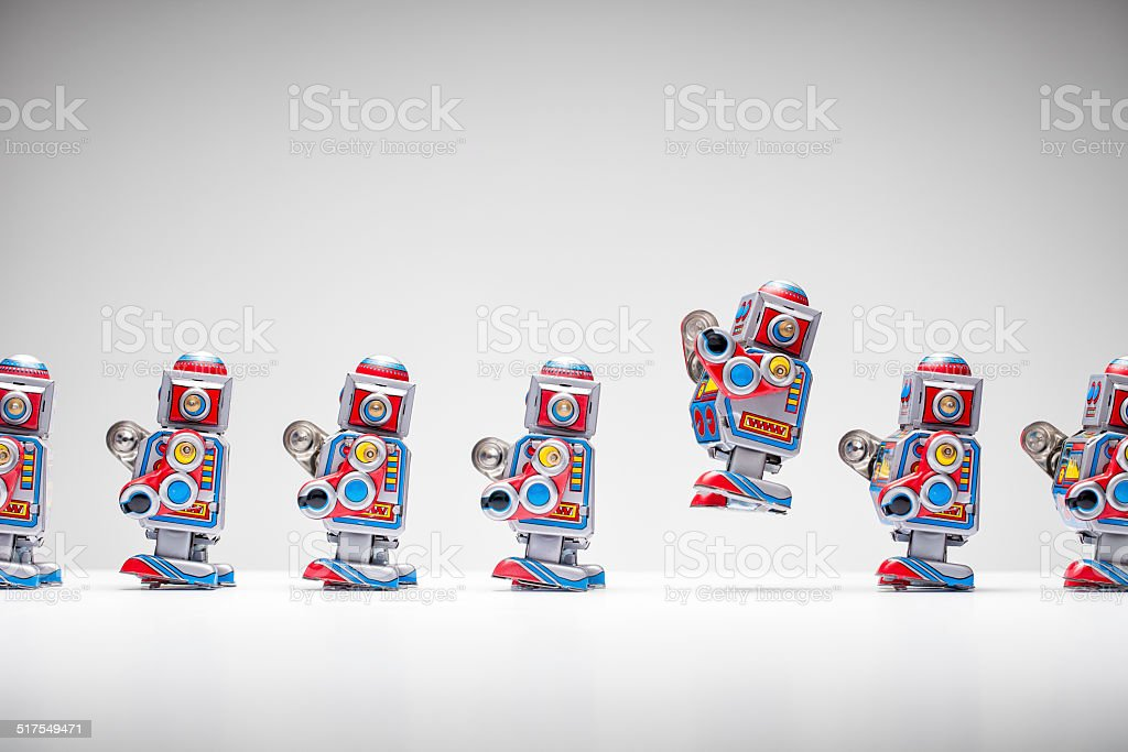 Retro tin toy robots standing in a row stock photo
