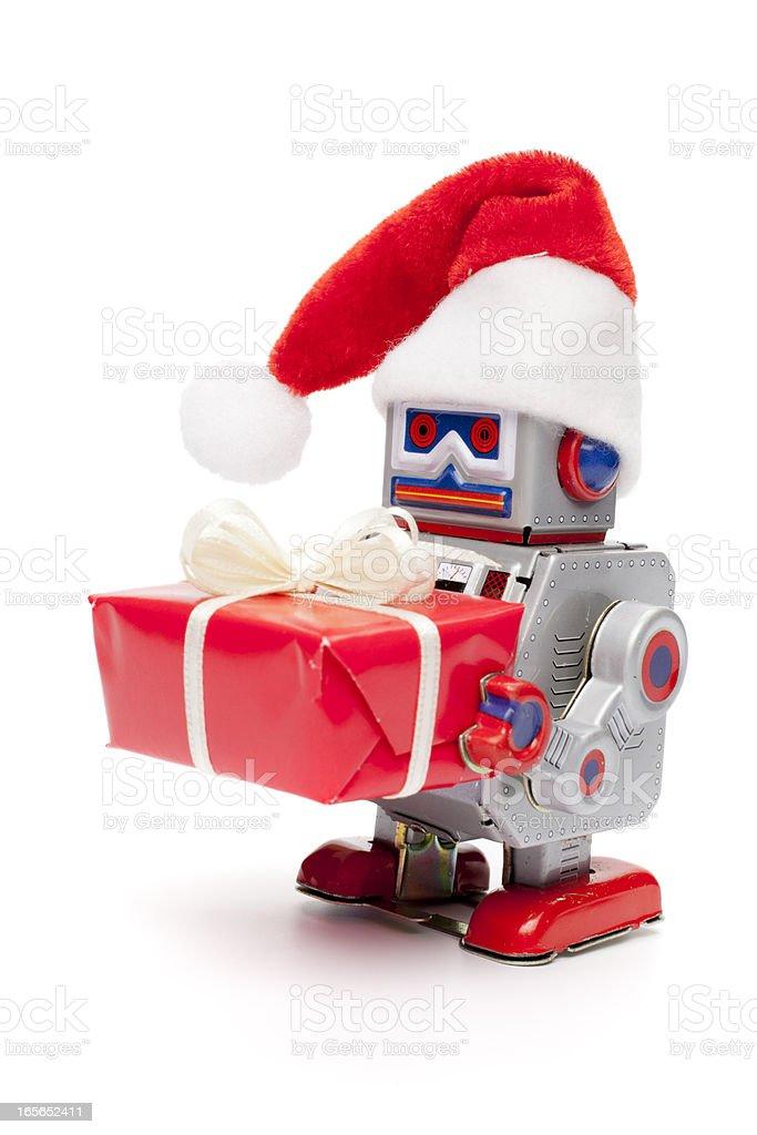 Retro tin toy santa robot holding christmas present royalty-free stock photo