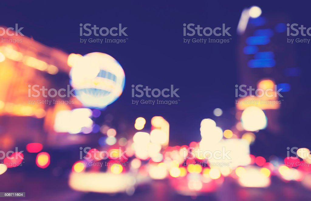 Retro toned blurred street lights, urban abstract background. stock photo