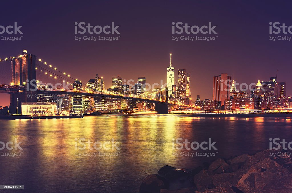 Retro toned New York waterfront at night, USA. stock photo