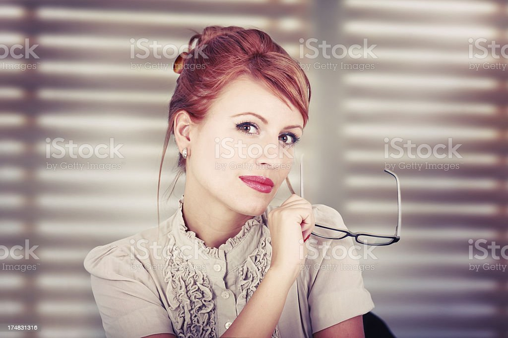 Retro toned portrait of a young redhead royalty-free stock photo