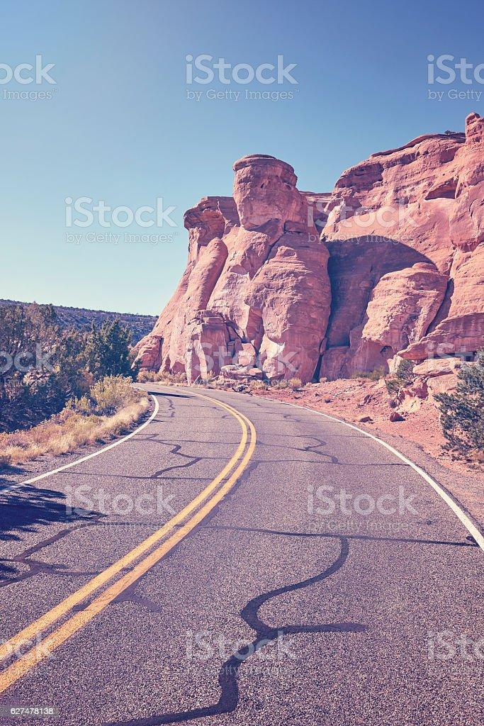 Retro toned scenic road, travel concept background, Colorado, US stock photo