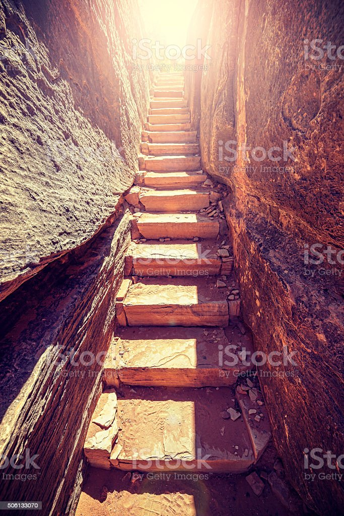 Retro toned stairs carved in stone. stock photo