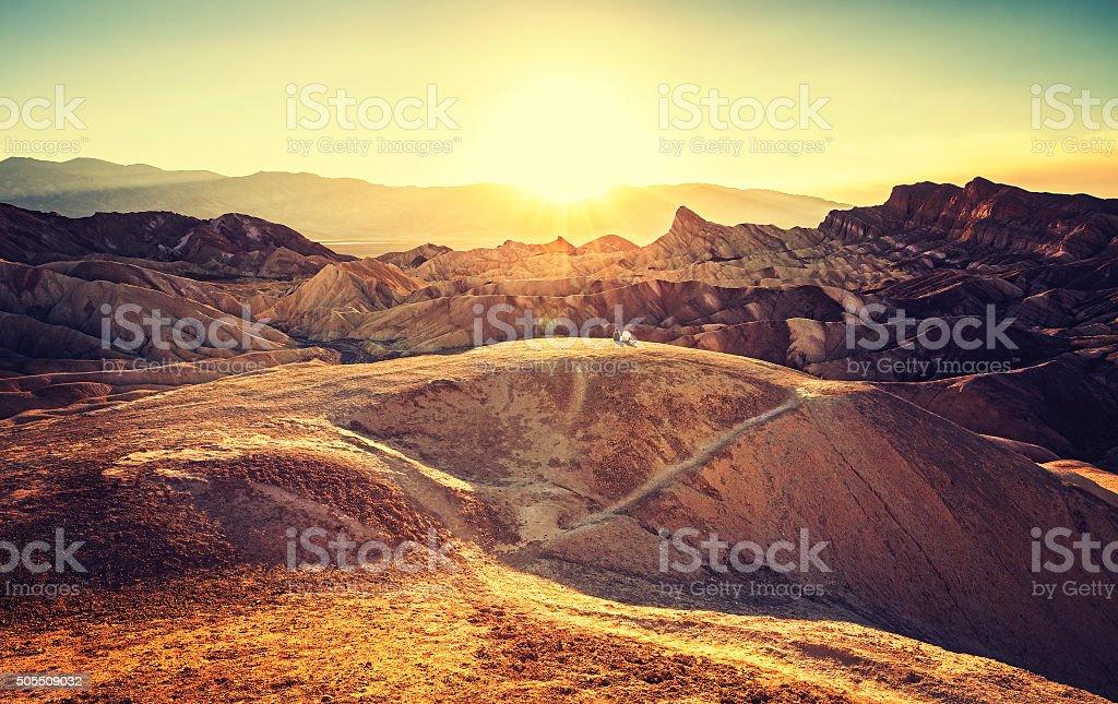 Retro toned sunset over Zabriskie Point, Death Valley, USA. stock photo