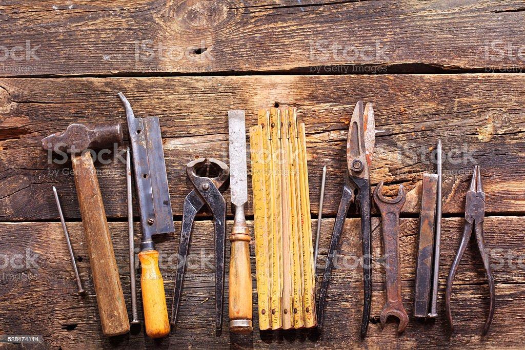retro tools on wooden background stock photo