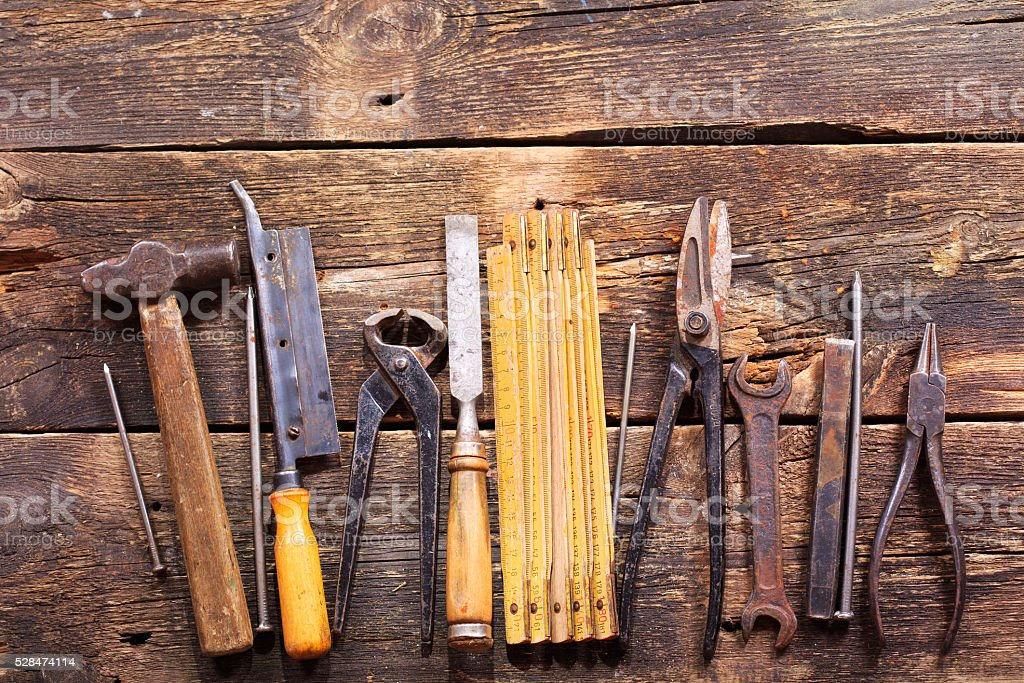 retro tools on wooden background stock photo