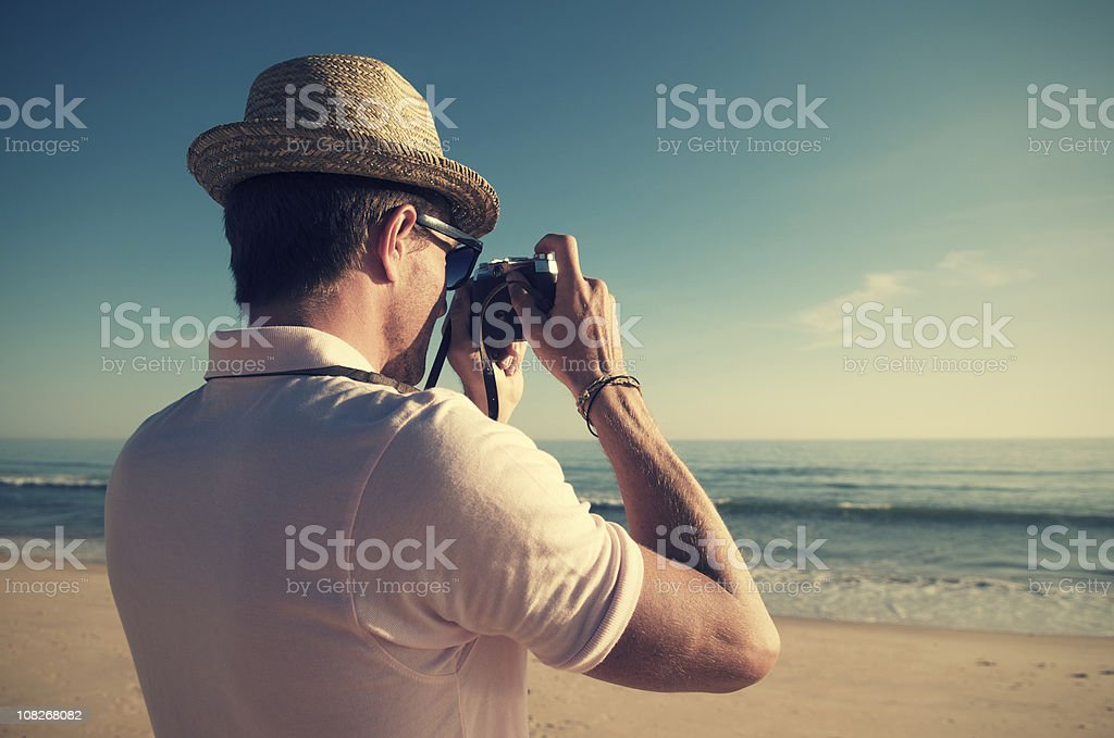 Retro Tourist Taking Pictures with Old-Fashioned Camera royalty-free stock photo