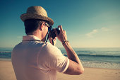 Retro Tourist Taking Pictures with Old-Fashioned Camera