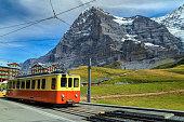 Retro tourist train and Eiger North face, Bernese Oberland, Switzerland